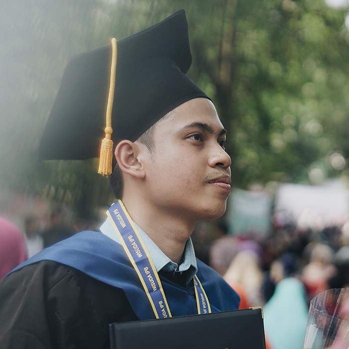 A newcomer graduating from college
