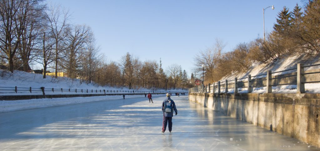 Ottawa residents skating on the Rideau Canal in winter.