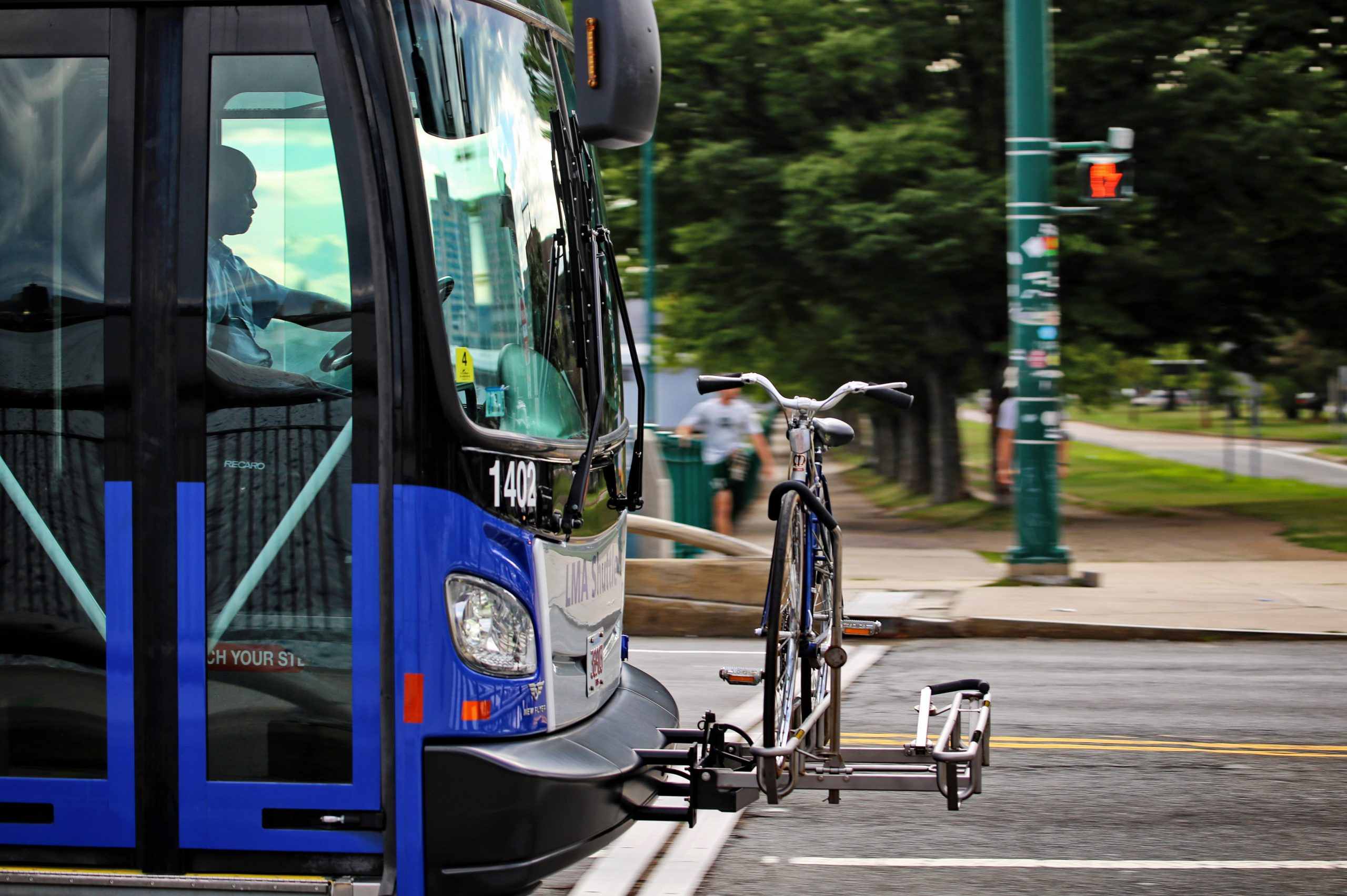 A bike rack on the front of a bus.