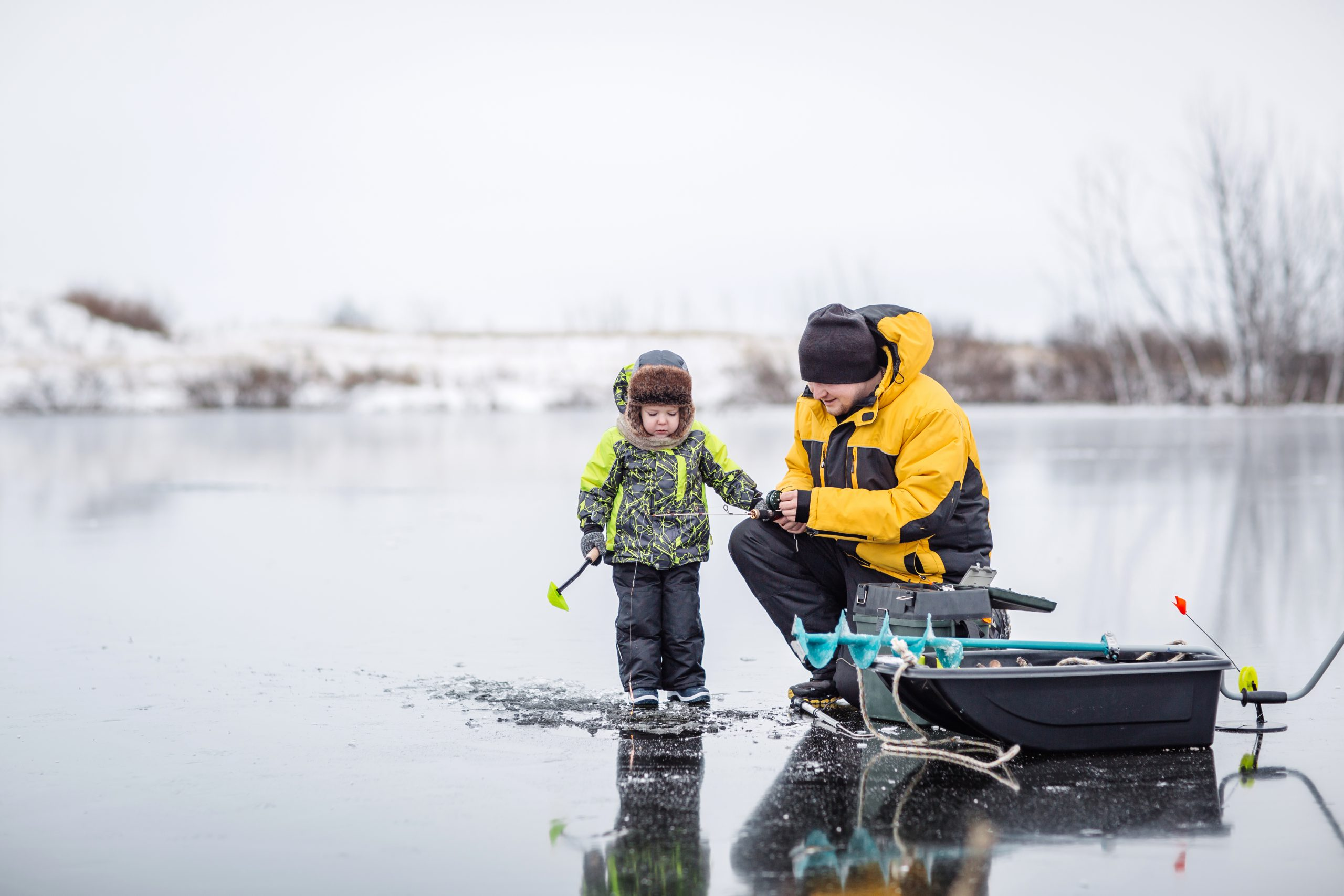 Father and son ice fishing