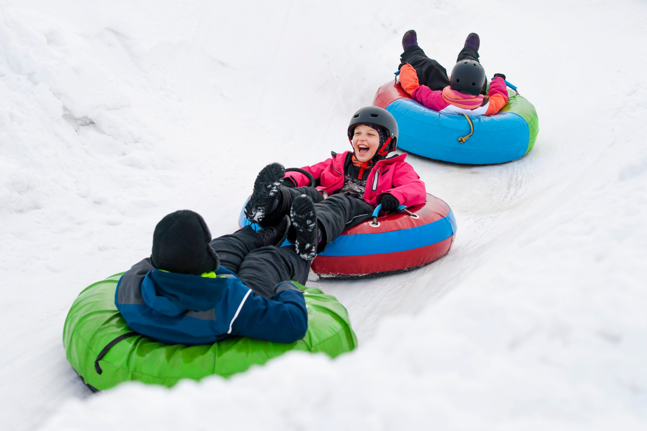 Children enjoying snow tubing
