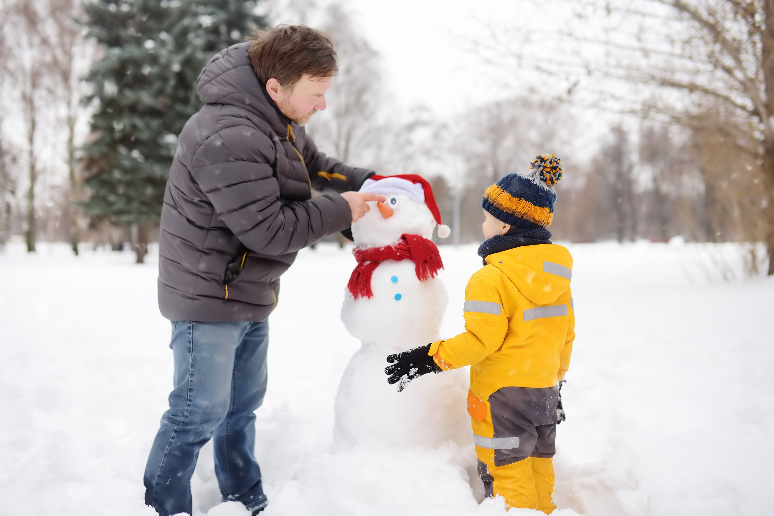 Father and son building a snowman