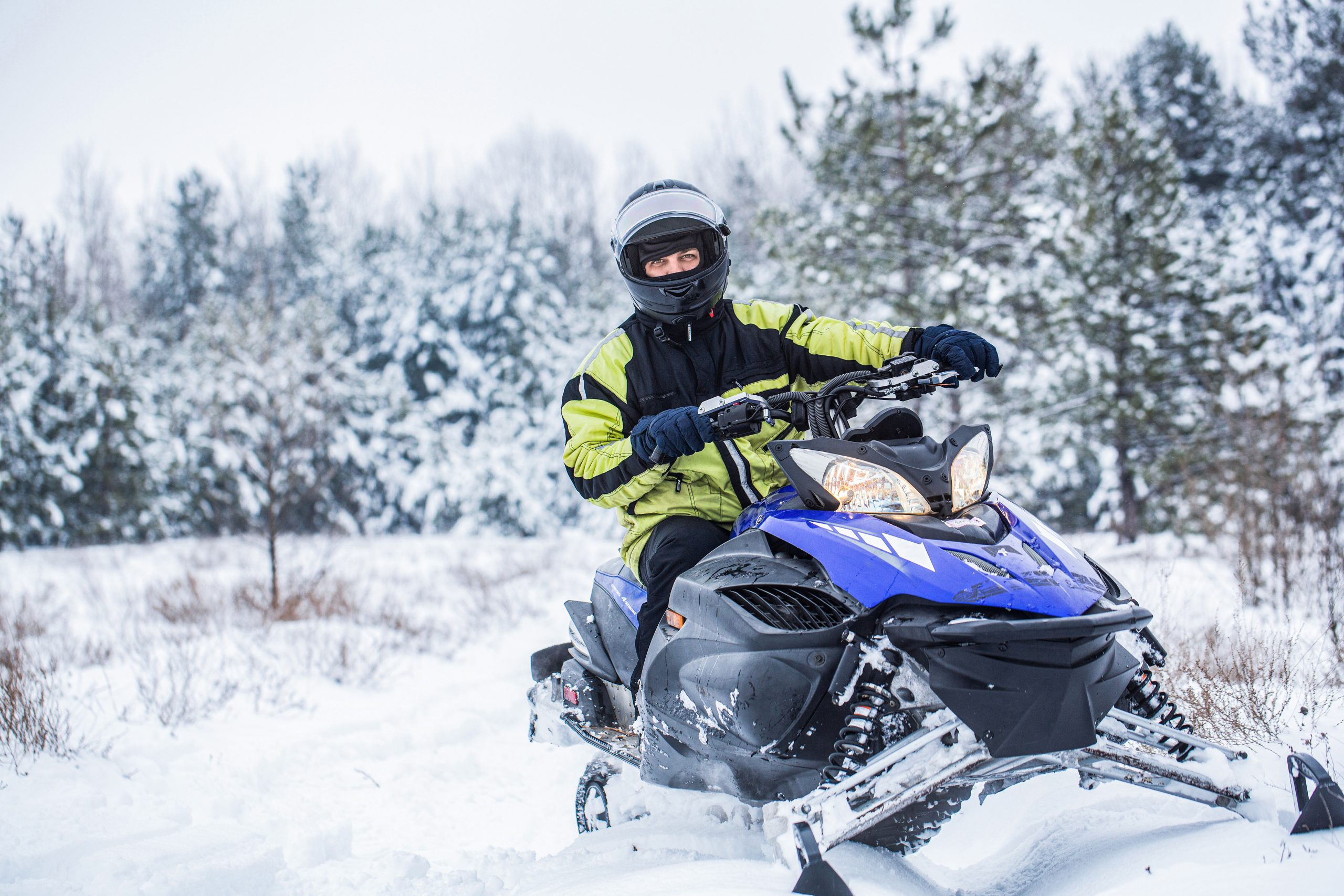 Man using a snowmobile